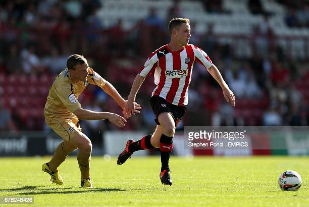 Brentford's Adam Forshaw and Colchester United's Anthony Wordsworth Brian Wilson battle for the ball