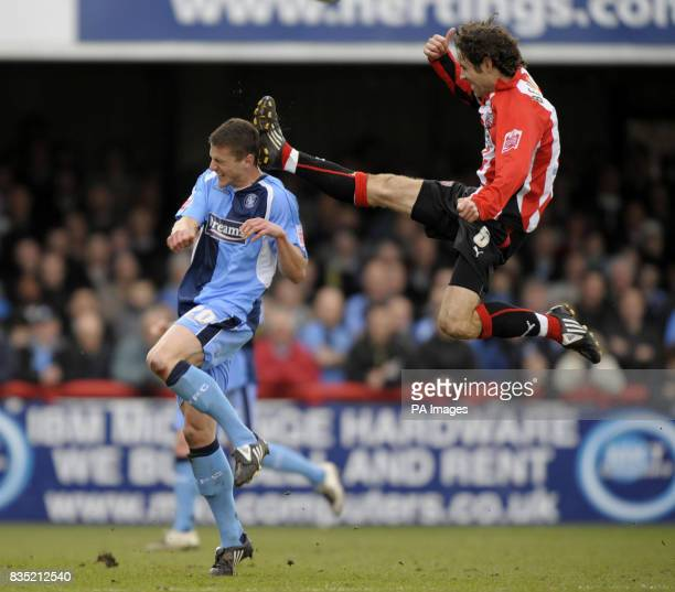 Brentford's Alan Bennet challenges Wycombe's John Mousinho with this high tackle which he is then booked for during the CocaCola League Two match at...