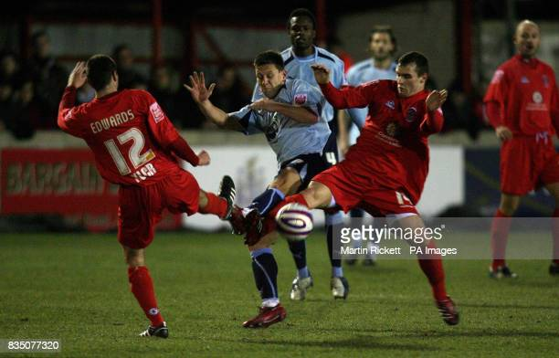 Brentford's Charlie McDonald battles with Accrington Stanley's Phil Edwards and James Ryan during the CocaCola League Two match at the Fraser Eagle...