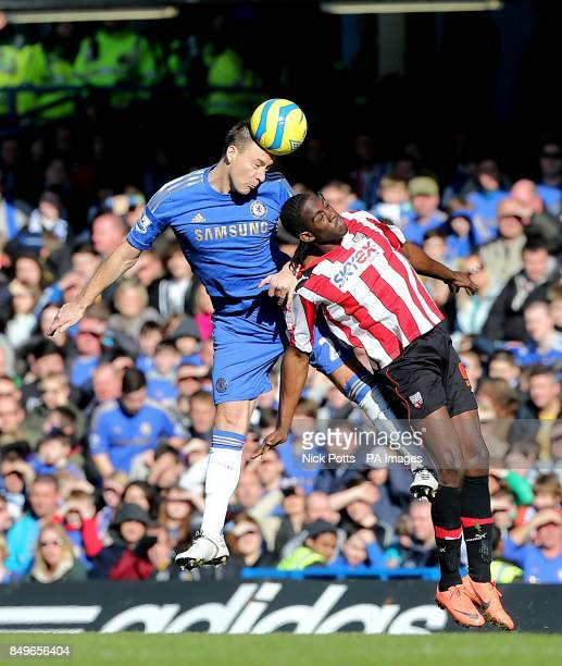 Brentford's Clayton Donaldson and Chelsea's John Terry battle for the ball in the air