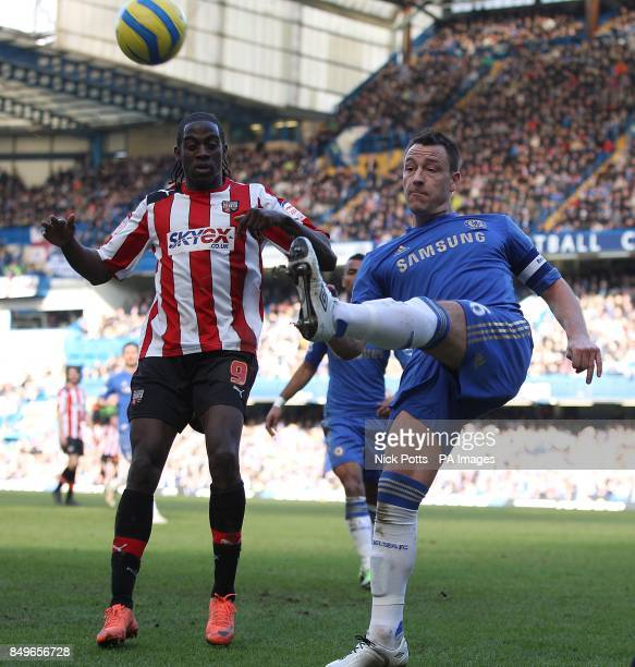 Brentford's Clayton Donaldson and Chelsea's John Terry battle for the ball