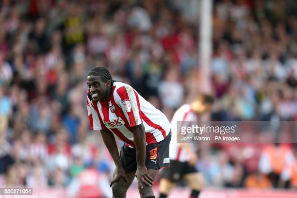 Brentford's Clayton Donaldson looks anxious as the whistle is blown at the end of extra time