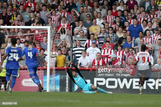 Brentford's Clayton Donaldson scores his teams third goal of the game