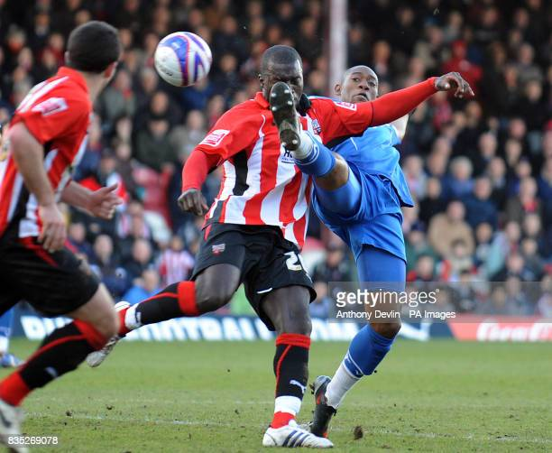 Brentford's Damian Spencer and Gillingham's Dennis Oli battle for the ball during the CocaCola League Two match at Griffin Park Brentford