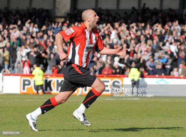 Brentford's David Hunt celebrates scoring during the CocaCola League Two match at Griffin Park Brentford