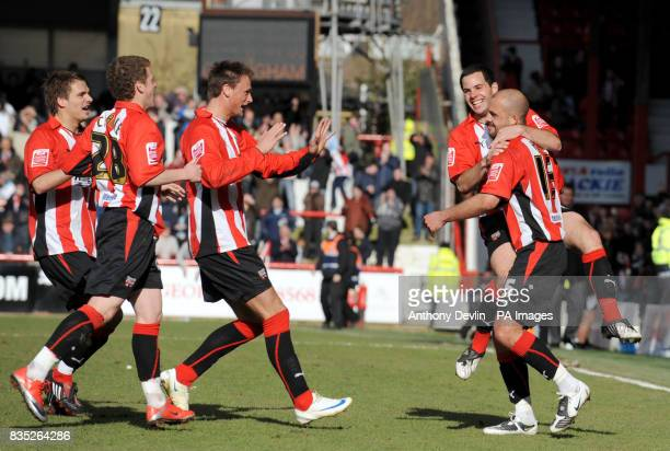 Brentford's David Hunt celebrates scoring with team mates during the CocaCola League Two match at Griffin Park Brentford