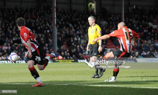 Brentford's David Hunt scores during the CocaCola League Two match at Griffin Park Brentford