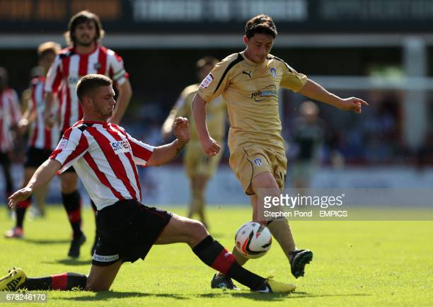 Brentford's Dean Harlee and Colchester United's Ian Henderson battle for the ball
