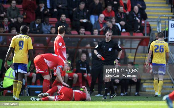 Brentford's James Tarkowski leaves the pitch after being shown the red card by referee Robert Madley during the Sky Bet League One match at the...