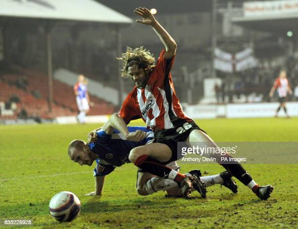 Brentford's John Halls and Chesterfield's Drew Talbot battle for the ball during the CocaCola League Two match at Griffin Park Brentford