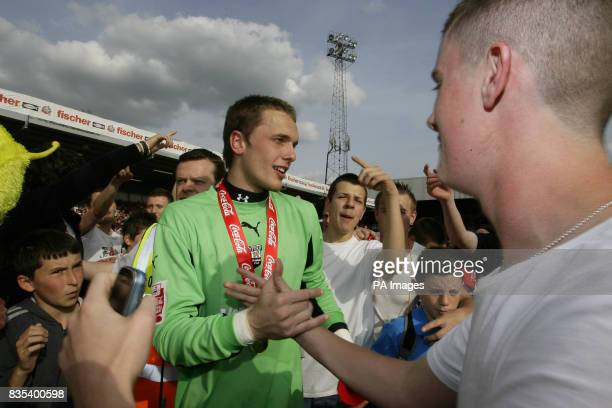 Brentford's keeper Ben Hamer celebrates with fans on the pitch after the match during the CocaCola Football League Two match at Griffin Park Brentford