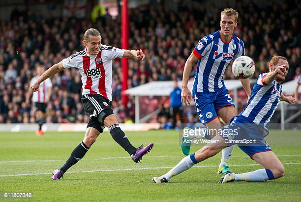 Brentford's Lasse Vibe's shot blocked by Wigan Athletic's Shaun MacDonald during the Sky Bet Championship match between Brentford and Wigan Athletic...