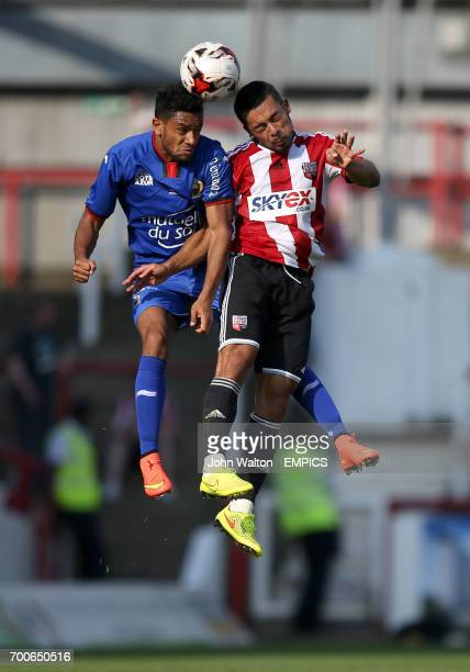Brentford's Nico Yennaris battles for possession of the ball with OGC Nice's Jordan Amavi