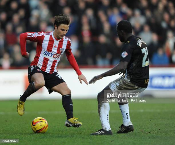 Brentford's Sam Saunders and Port Vale's Anthony Griffiths during the Sky Bet League One match at Griffin Park Brentford