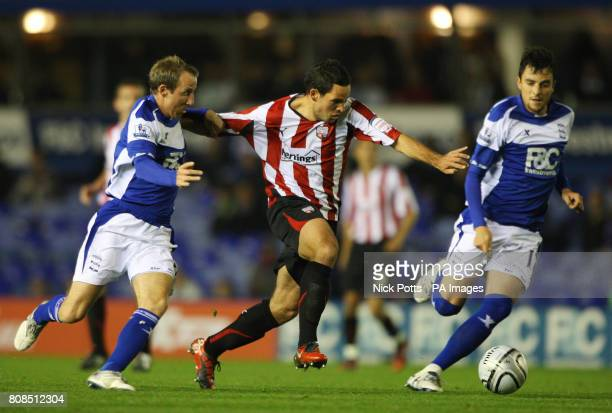 Brentford's Sam Wood holds off a challenge from Birmingham City's Lee Bowyer and Michel during the Carling Cup Fourth Round match at St Andrew's...
