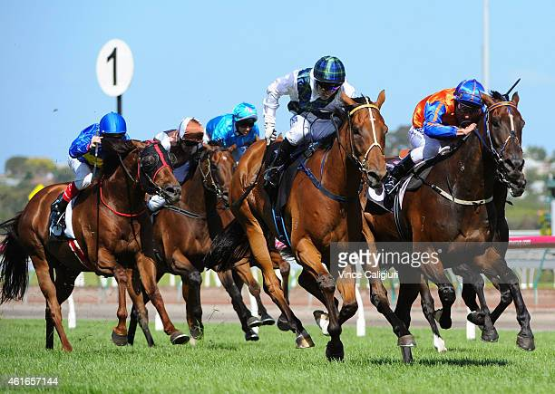 Brenton Avdulla riding Red Excitement defeats Damien Oliver riding Tried And Tired in Race 7 the Chester Manifold Stakes during Melbourne Racing at...
