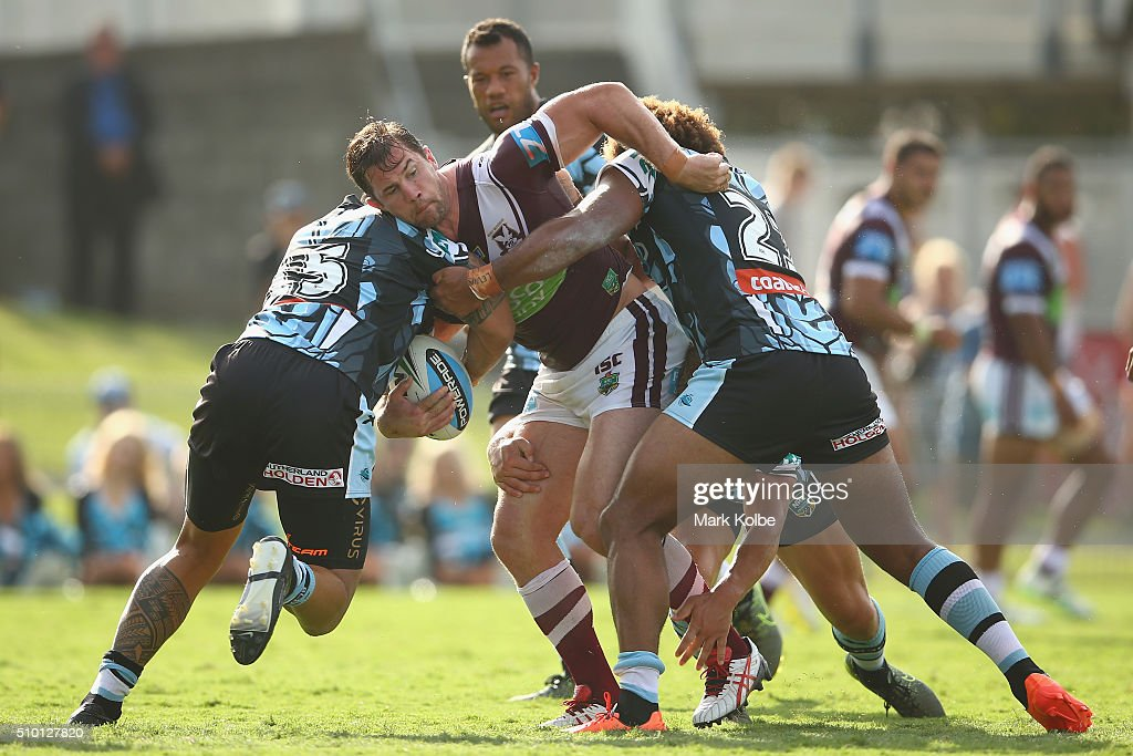 Brenton Lawrence of the Eagles is tackled during the NRL Trial match between the Cronulla Sharks and the Manly Sea Eagles at Remondis Stadium on February 14, 2016 in Sydney, Australia.