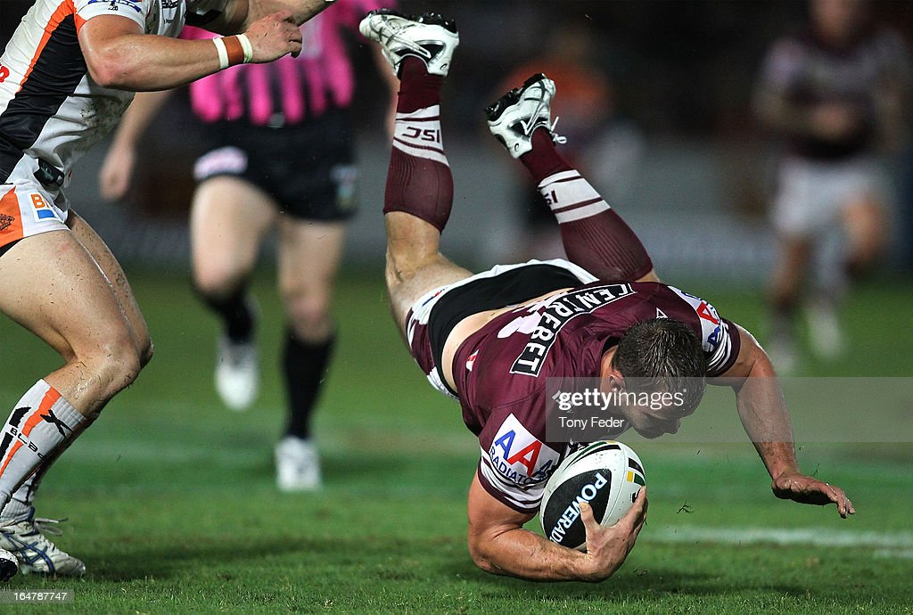 Brenton Lawrence of the Sea Eagles dives with the ball during the round four NRL match between the Manly Sea Eagles and the Wests Tigers at Bluetongue Stadium on March 28, 2013 in Gosford, Australia.