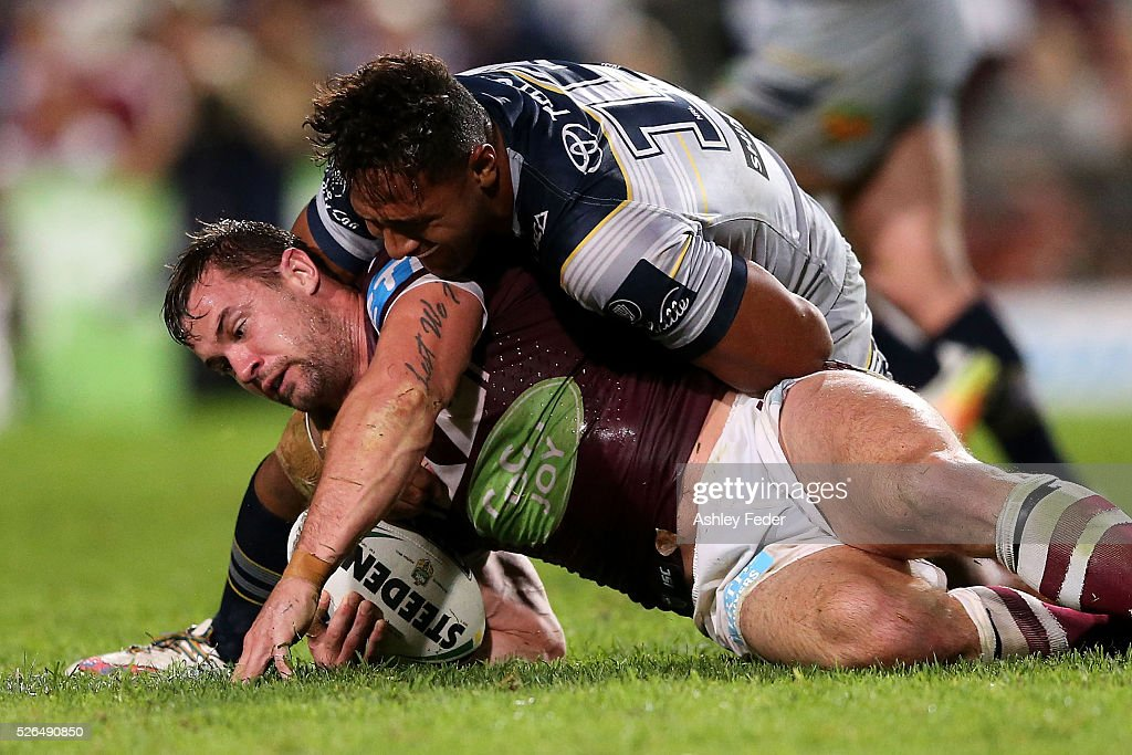 Brenton Lawrence of the Sea Eagles is tackled by Patrick Kaufusi of the Cowboys during the round nine NRL match between the Manly Sea Eagles and the North Queensland Cowboys at Brookvale Oval on April 30, 2016 in Sydney, Australia.