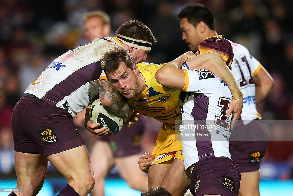 Brenton Lawrence of the Sea Eagles is tackled by the Broncos defence during the round 21 NRL match between the Manly-Warringah Sea Eagles and the Brisbane Broncos at Brookvale Oval on August 1, 2014 in Sydney, Australia.