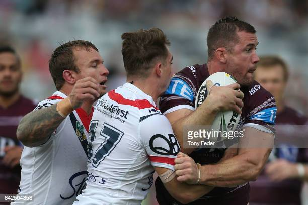 Brenton Lawrence of the Sea Eagles is tackled by the Roosters defence during the NRL Trial match between the Manly Warringah Sea Eagles and Sydney...