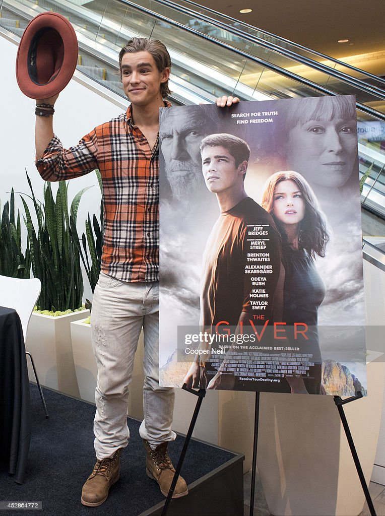 Brenton Thwaites poses for a photo during 'The Giver' Color Party at NorthPark Center on July 28 2014 in Dallas Texas