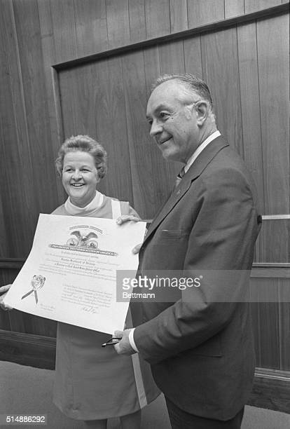 Brereton Sturtevant of Wilmington Delaware holds her certificate of appointment following her taking the oath of office as examinerinchief board of...