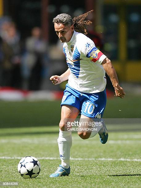 Brescia's captain Roberto Baggio kicks the ball during their Italian Serie A football match against AC Milan at San Siro stadium in Milan 16 May 2004...