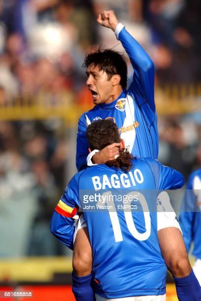Brescia's Francelino Matuzalem celebbrates scoring the opening goal with Roberto Baggio