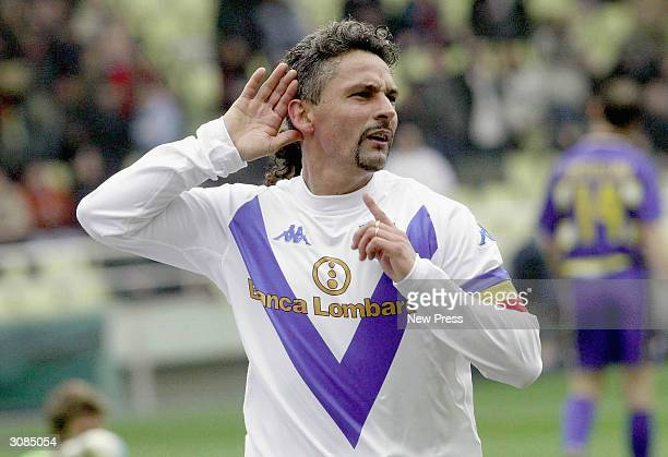 Brescia's Roberto Baggio celebrates scoring his 200th Serie A career goal during the Serie A match between Parma and Brescia on March 14 2004 in...