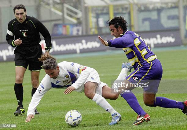Brescia's Roberto Baggio goes down after a challenge by Parma's Simone Barone during the Serie A match between Parma and Brescia on March 14 2004 in...