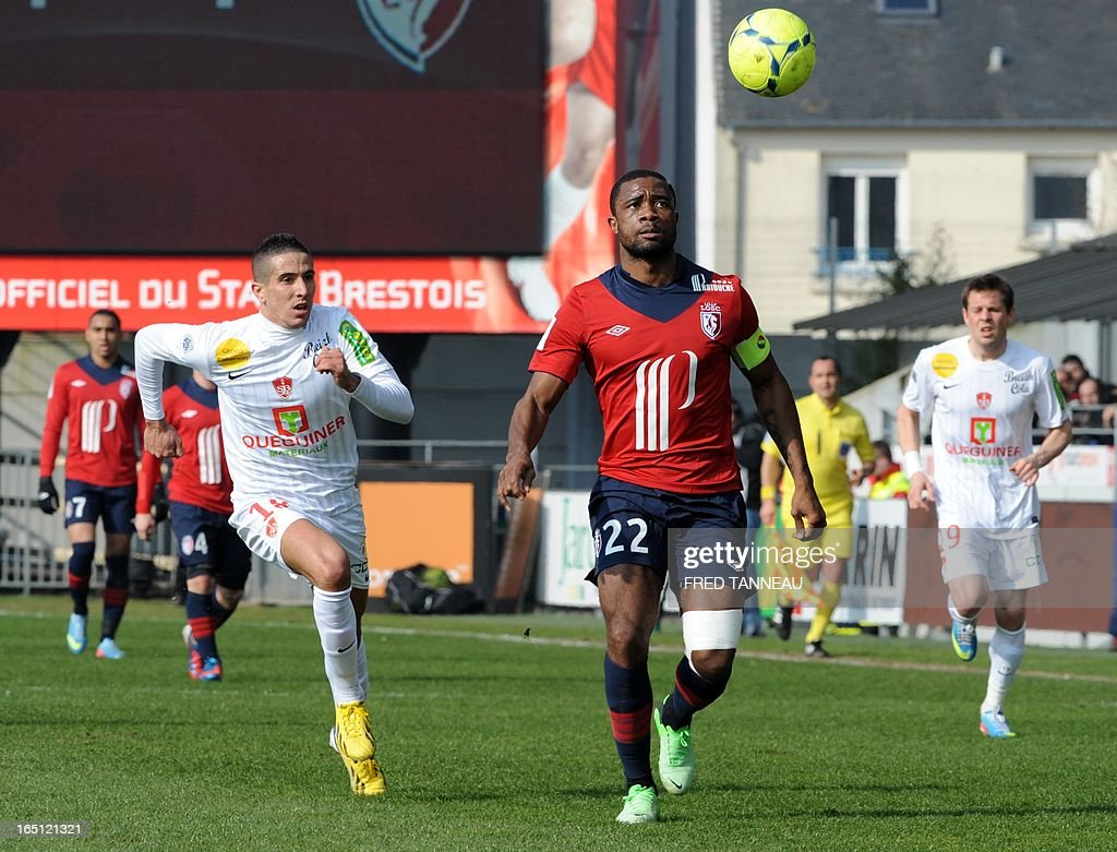 Brest's Brest's French midfielder Florian Raspentino (L) vies for the ball with Lille's Cameroonian midfielder Aurelien Chedjou Fongang during the French L1 match Brest vs Lille at the Francis Le Blé stadium on March 31, 2013 in Brest, western France.