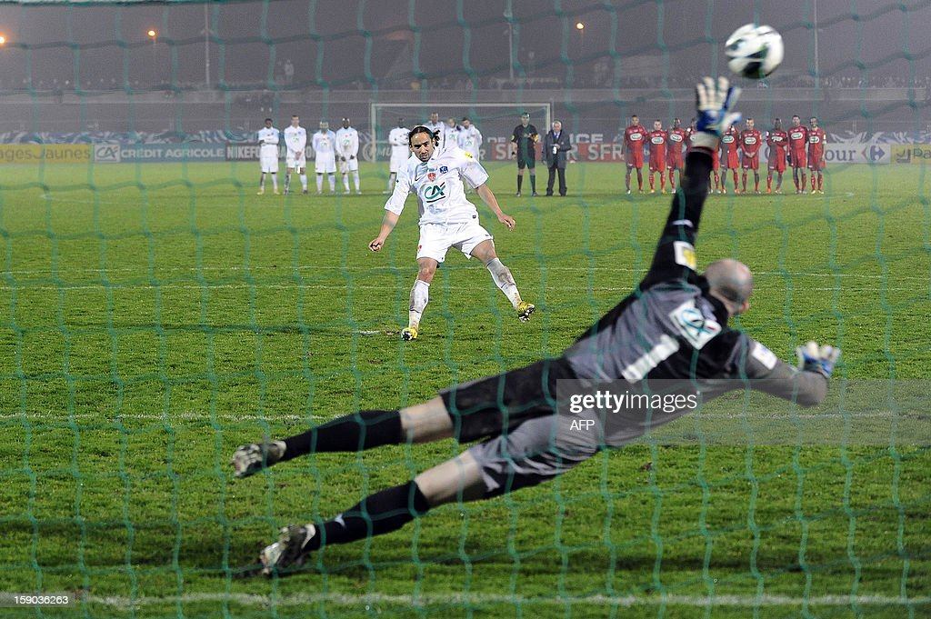 Brest's Bruno Grougi kicks a penalty against Lucon's goalkeeper Damien Leclere during the French cup football match Lucon vs Brest on January 6, 2013 at the Henri Desgranges Stadium in La Roche-sur-Yon, western France. AFP PHOTO JEAN-SEBASTIEN EVRARD