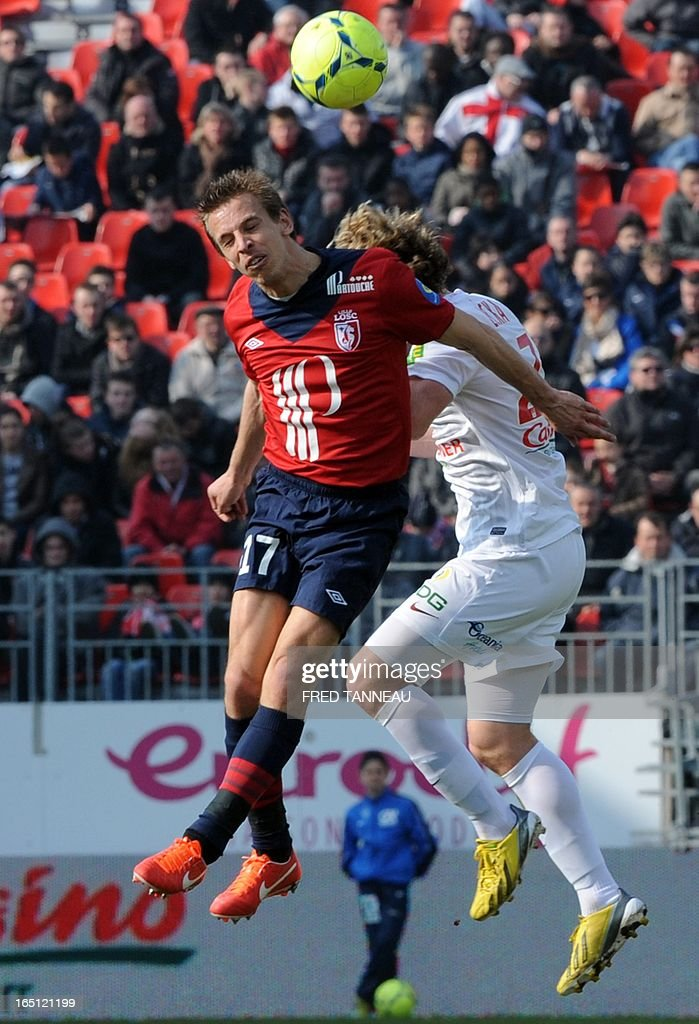 Brest's Czech midfielder Mario Licka (R) vies for the ball with Lille's French midfielder Benoit Pedretti during the French L1 match Brest vs Lille at the Francis Le Blé stadium on March 31, 2013 in Brest, western France.