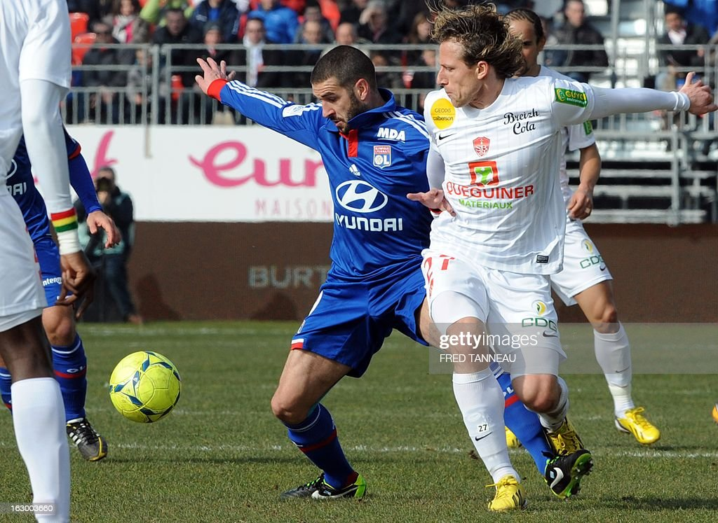 Brest's Czech midfielder Mario Licka (R) vies with Lyon's Argentinian forward Lisandro Lopez during the French L1 football match Brest vs Lyon at the Francis Le Ble stadium on March 3, 2013 in Brest, western of France.