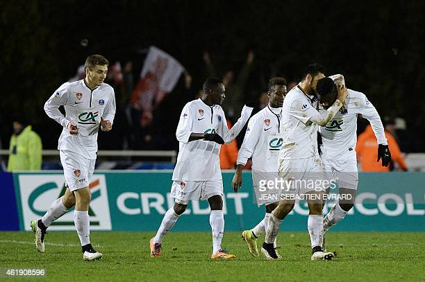 Brest's defender Ismael Traore celebrates with his teammates after scoring during the French Cup football match Cholet vs Brest at the PierreBlouen...