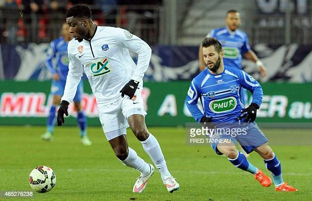 Brest's defender Ismael Traore vies with Auxerre's forward Frédéric Sammaritano during the French Cup football match between Brest and Auxerre on...