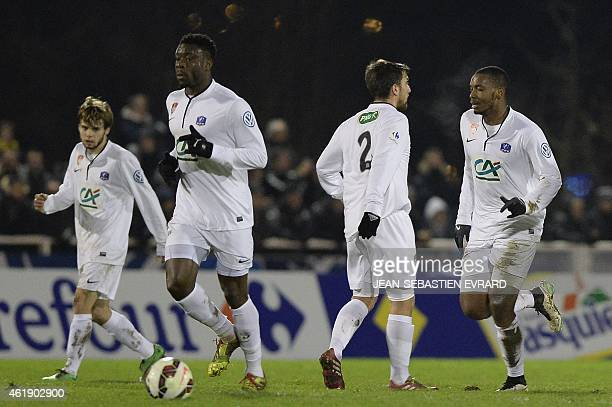 Brest's defender Johan Martial celebrates with teammates after scoring during the French Cup football match Cholet vs Brest on January 21 2015 at the...