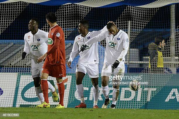 Brest's defender Johan Martial is congratulated by teammates after scoring during the French Cup football match Cholet vs Brest on January 21 2015 at...