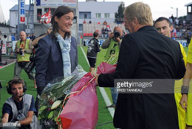 Brest's French coach Alex Dupont offers flowers for her birthday to ClermontFerrand's French coach Corinne Diacre prior to the French L2 football...
