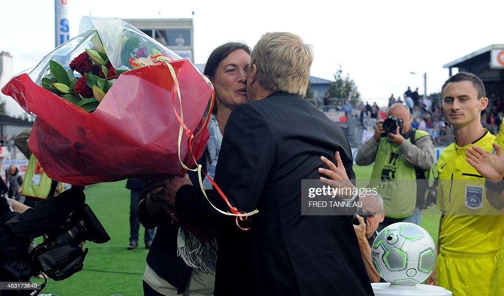 Brest's French coach Alex Dupont (2nd R) offers flowers for her birthday to Clermont-Ferrand's French coach Corinne Diacre prior to the French L2 football match between Brest and Clermont-Ferrand on August 4, 2014 at the Francis Le Ble stadium in Brest, western France. Diacre is the first woman to lead a men's professional team in a major European country. Diacre was hired after Clermont's original choice, another woman, Portuguese Helena Costa, resigned abruptly the day before taking charge of the team.