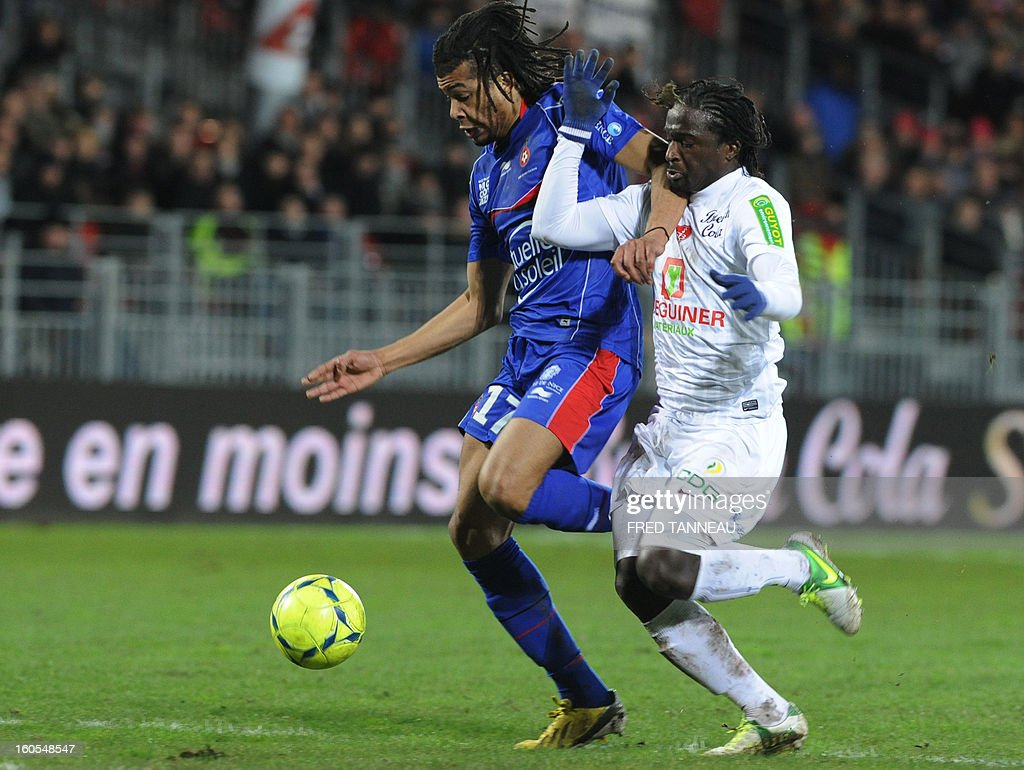 Brest's French defender Bernard Mendy (R) vies with Nice's French midfielder Kevin Anin during the French L1 football match Brest vs Nice at the Francis Le Ble stadium on February 2, 2013 in Brest, western France.