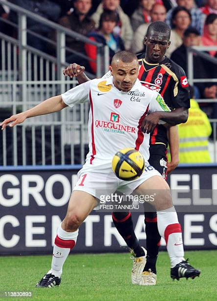 Brest's french defender Brahim Ferradj vies with Nice's midfielder Abdou Traore during the French L1 football match Brest vs Nice at the Francis Le...