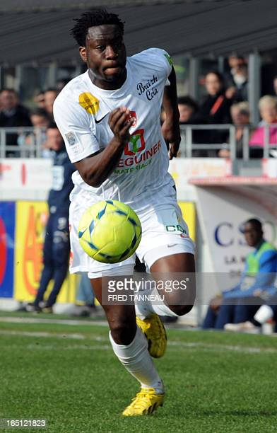 Brest's French defender Ismael Traore runs with the ball during the French L1 football match Brest vs Lille on March 31 2013 at the Francis Le Ble...