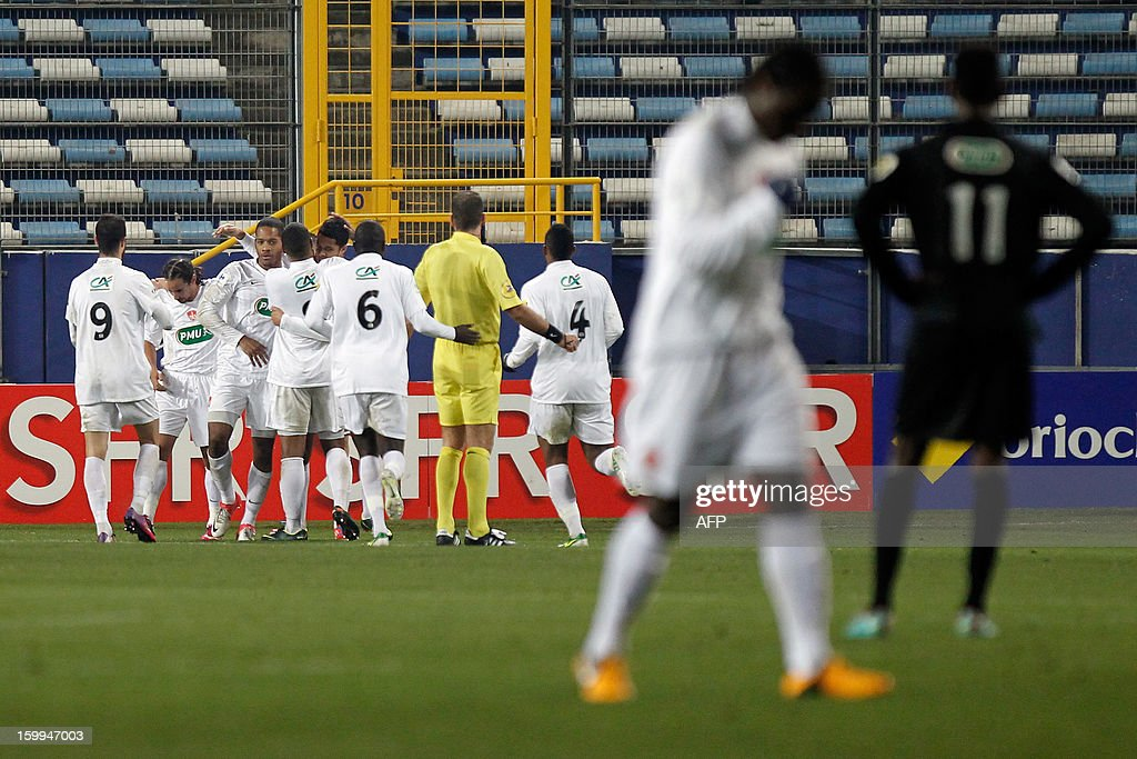 Brest's French defender Johan Martial is congratulated by teammates after scoring a goal during the French football Cup match CA Bastia (CAB) vs Brest (SB29) at the Armand Cesari stadium in Bastia, French Mediterranean island of Corsica, on January 23, 2013.