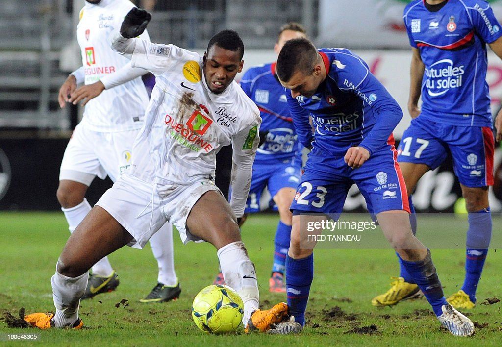 Brest's French defender Johan Martial (L) vies with Nice's French forward Alexy Bosetti during the French L1 football match Brest vs Nice at the Francis Le Ble stadium on February 2, 2013 in Brest, western France.