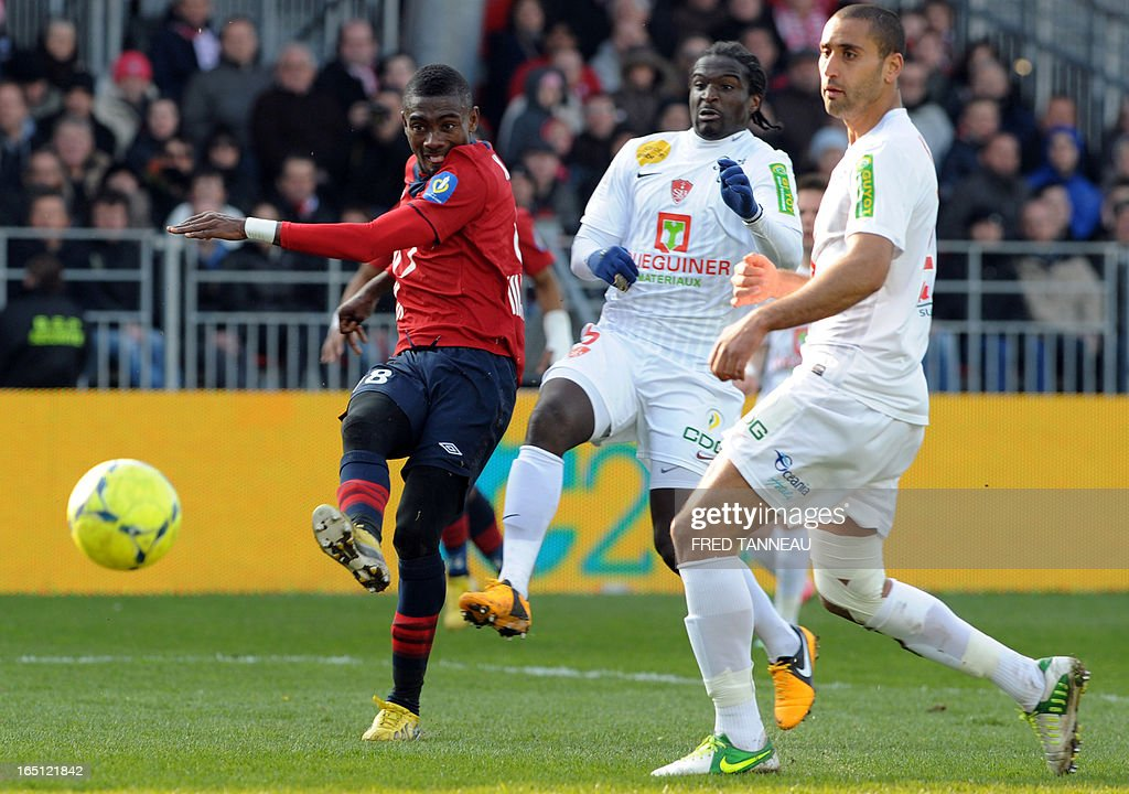 Brest's French defenders Bernard Mendy (C) and Ahmed Kantari (R) react as Lille's Ivoirian forward Salomon Kalou (L) kicks the ball during the French L1 football match Brest vs Lille on March 31, 2013 at the Francis Le Ble stadium in Brest, western France.