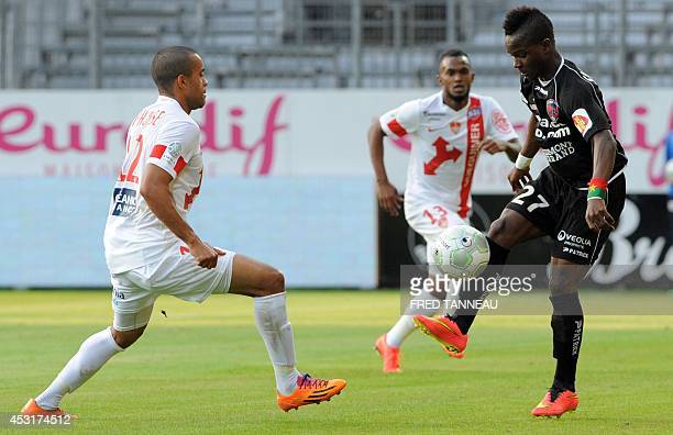 Brest's French forward Alexandre Alphonse vies for the ball with ClermontFerrand's midfielder Souleymane Sawadogo during the French L2 football match...