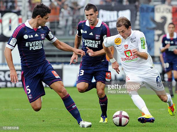 Brest's french forward Nolan Roux vies with Lyon's croatian defender Dejan Lovren during the French L1 football match Brest vs Lyon August 20 2011 in...