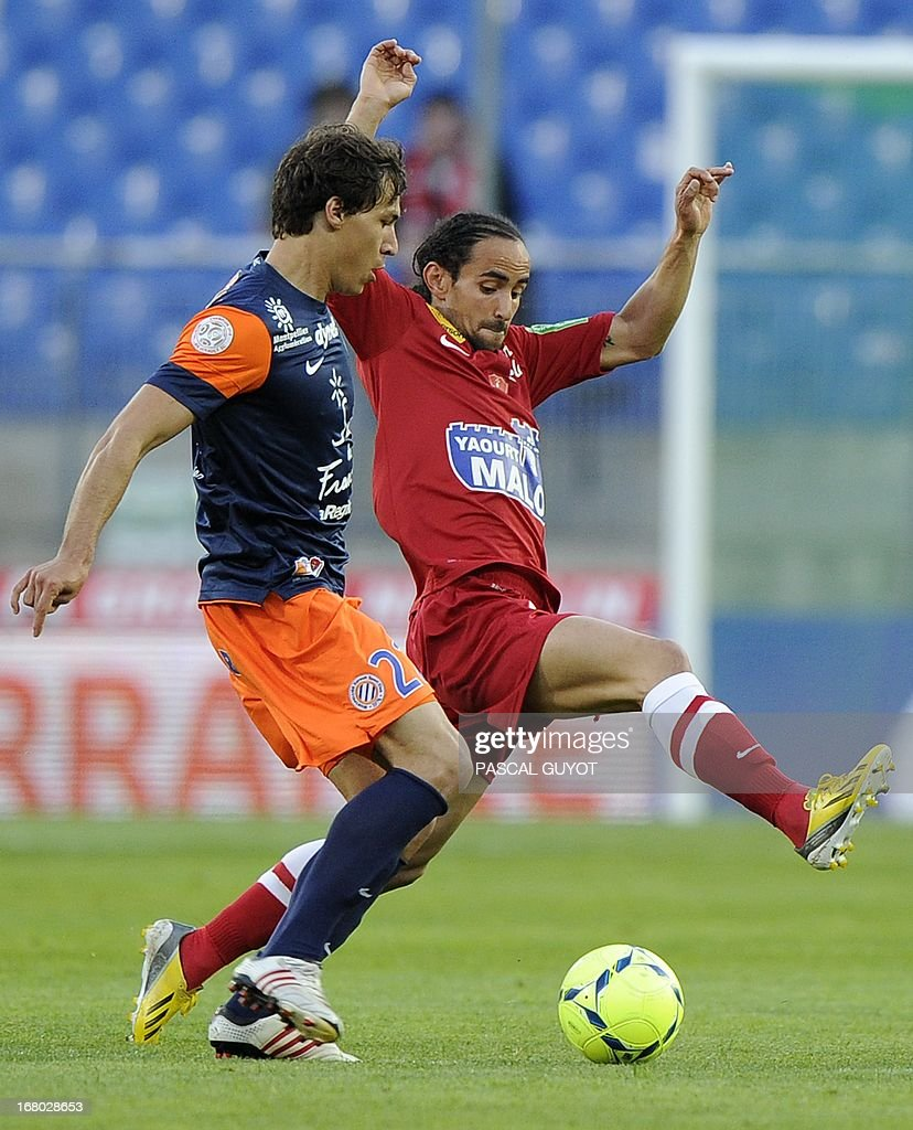 Brest's French midfielder Bruno Grougi (R) vies for the ball with Montpellier's French defender Benjamin Stambouli (L) during the French L1 football match Montpellier vs Brest on May 4, 2013 at the Mosson stadium in Montpellier, southern France.